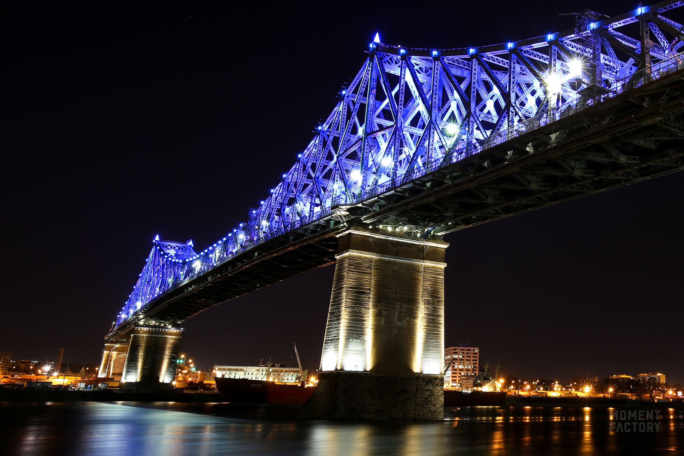 Jacques Cartier Bridge Illumination Reflects The Vibrant
