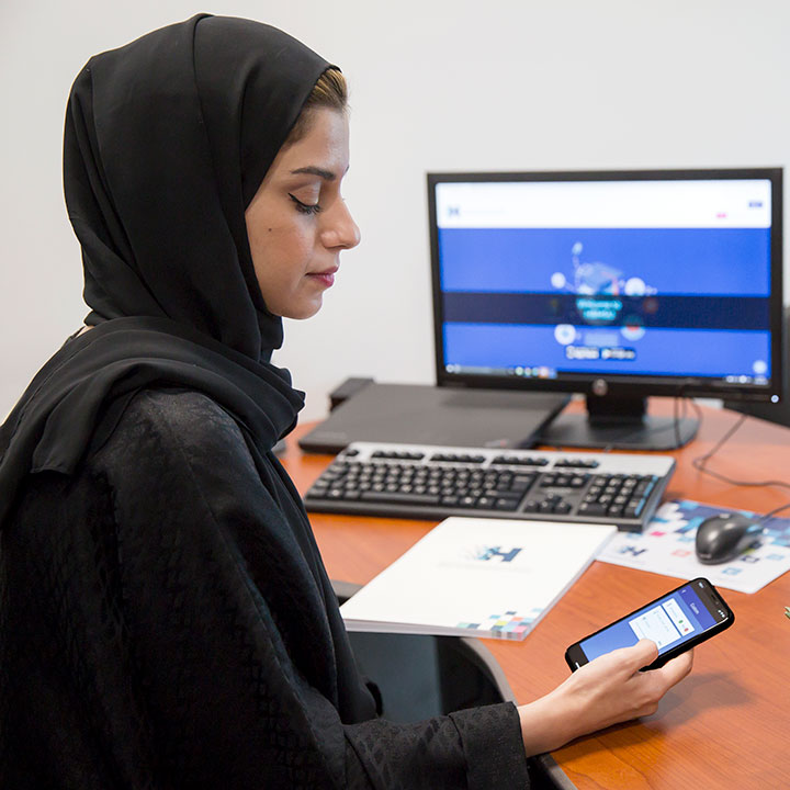 Smart university woman with phone with Interact Software